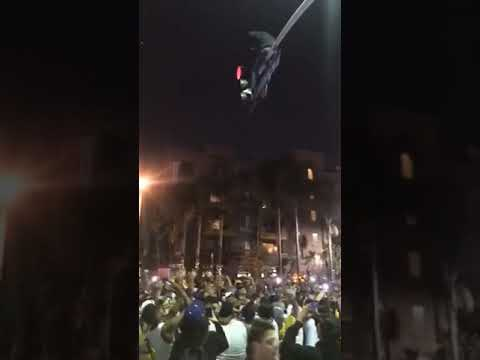 Man Drops From Los Angeles Streetlight Into Crowd of Celebrating Lakers Fans